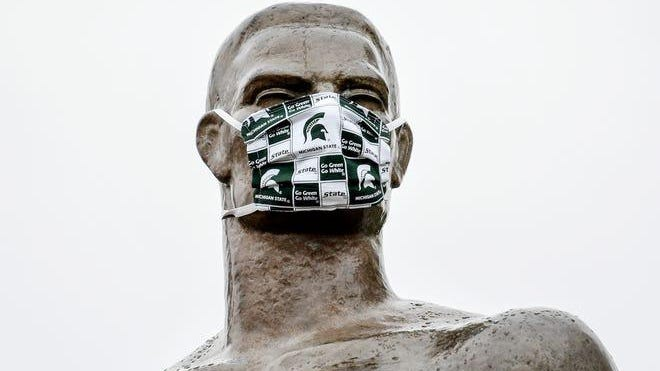 Sparty wears a Spartan mask on Wednesday, April 22, 2020, on the Michigan State University campus in East Lansing.