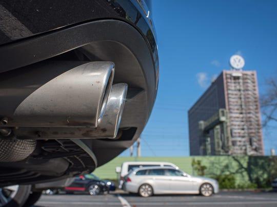 The exhaust pipe of a Volkswagen Passat in front of the Volkswagen headquarters in Wolfsburg, Germany, 25 September 2015.
