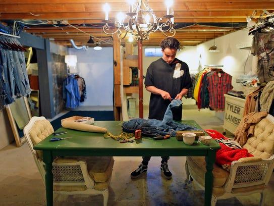 Fashion designer Tyler Lambert works in his studio