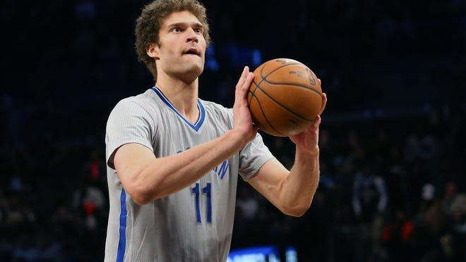 Apr 15, 2015; Brooklyn, NY, USA; Brooklyn Nets center Brook Lopez (11) shoots a free throw during the third quarter against the Orlando Magic at Barclays Center. Brooklyn Nets won 101-88. Mandatory Credit: Anthony Gruppuso-USA TODAY Sports
