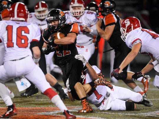York Suburban's Teague Hoffman tries to slip the grip of a Susquehannock player during a game last season. Hoffman and the graduated Dajour Henderson tied for a team-best seven rushing touchdowns last year.