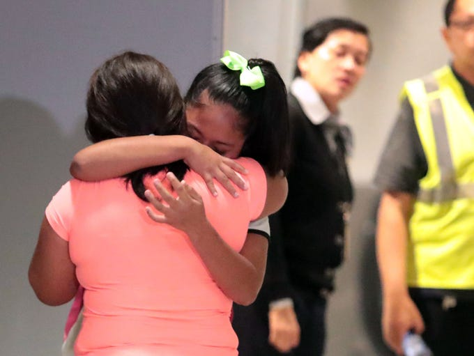 Yoselin Yamileth Velasquez Alemengor, 12, cries as