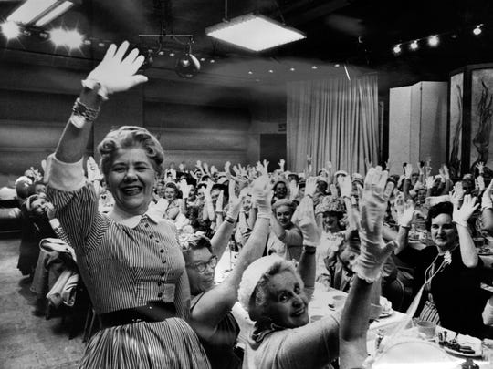 "Ruth Lyons had her audience wave to viewers every show to her ""Waving Song."" In this photo, Lyons and the audience has on the signature white gloves she popularized."