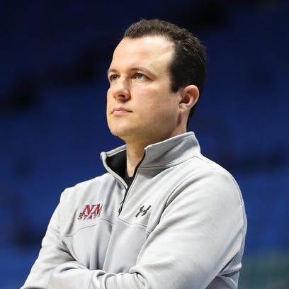 New Mexico State head coach Paul Weir looks on during