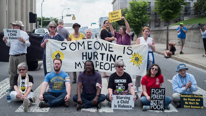 Protestors with the Tennessee Poor People's Campaign block Charlotte Ave. outside of the Tennessee State Capitol, May 14, 2018, in Nashville, Tenn.