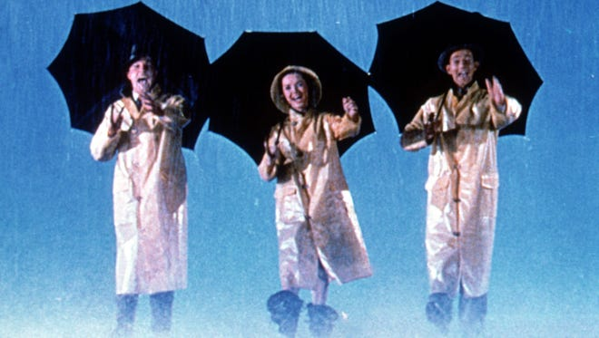 """Gene Kelly (left) Debbie Reynolds and Donald O'Connor star in """"Singin' In The Rain."""""""