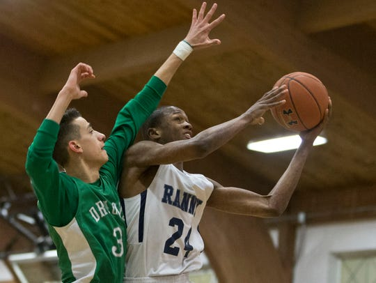 Ranney's Scottie Lewis (24) goes to the hoop as Brick's