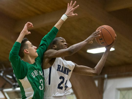 Ranney's Scottie Lewis (24) goes to the hoop as Brick's Noah Buono defends in Tuesday night's Shore Conference Tournament game, won by Ranney, 75-51.