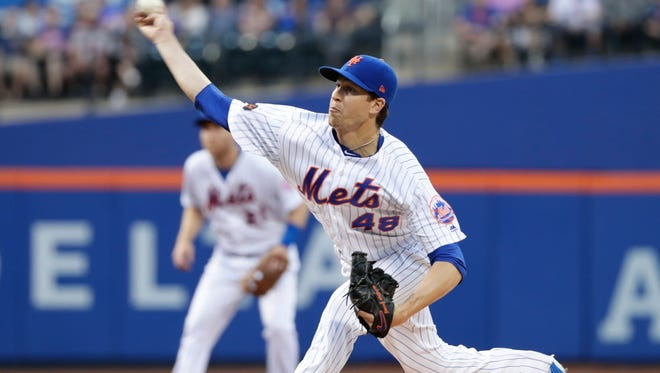 New York Mets' Jacob deGrom delivers a pitch during the first inning of the team's baseball game against the Atlanta Braves on Wednesday, May 2, 2018, in New York.