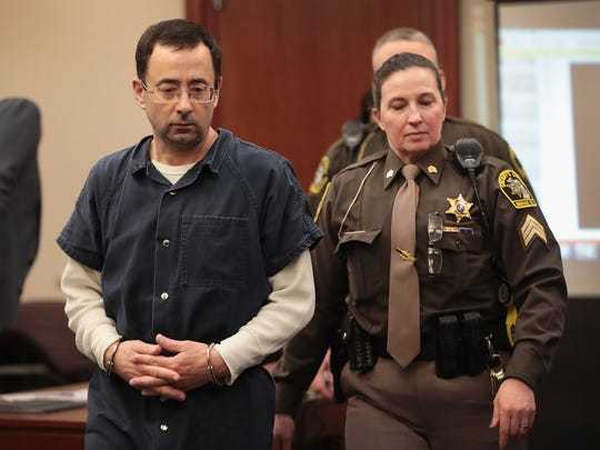 Larry Nassar appears in court on to listen to victim-impact statements prior to being sentenced after being accused of molesting about 100 girls while he was a physician for USA Gymnastics and MSU where he had his sports-medicine practice on January 16, 2018 in Lansing.