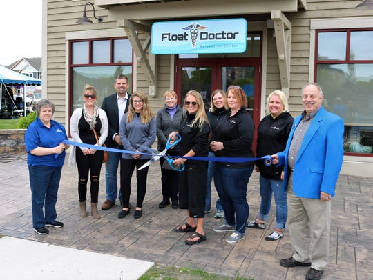 Sheboygan's Float Doctor holds their ribbon cutting.