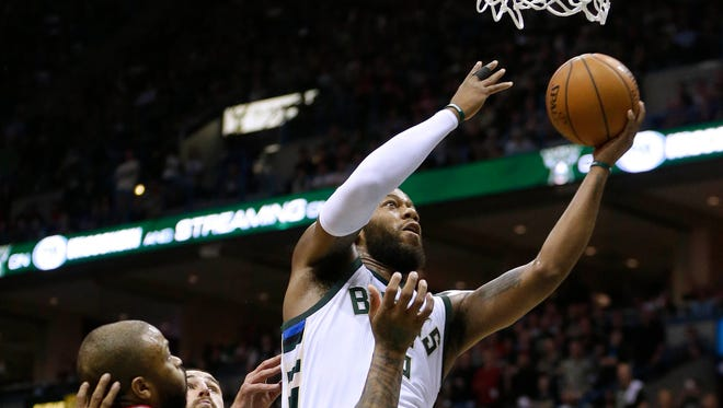 Bucks center Greg Monroe scores two of his 14 points.