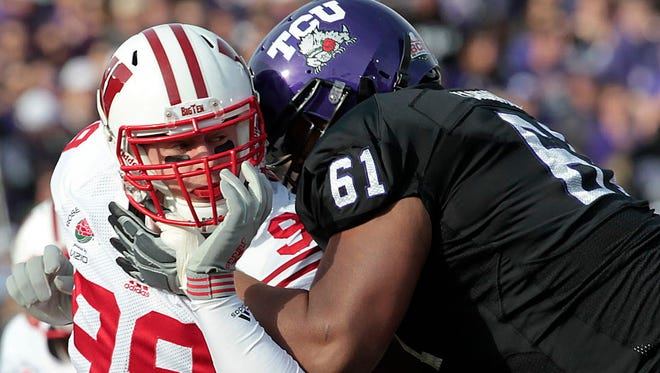 J.J. Watt (left), who now stars for the Houston Texans, is one of seven former UW walk-ons currently playing in the NFL.