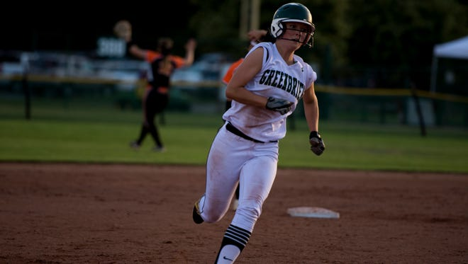 Kaylee Rector of Greenbrier runs into third, and then home, after her teaamate hit a home-run against Elizabethton.