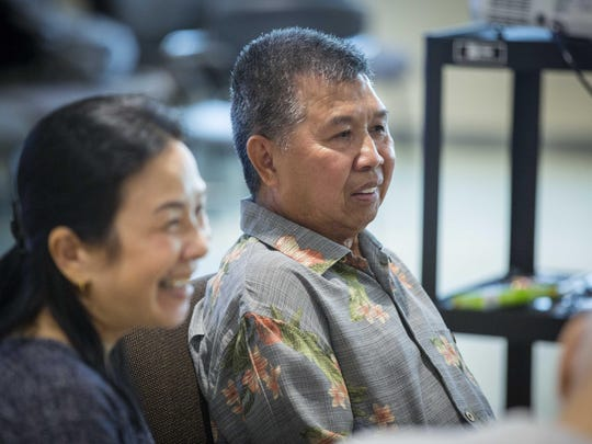 Phoukham Tran, right and his wife Chalouaiphone, answer questions at the YMCA Healthy Living Center in Clive Thursday Aug. 11, 2016, during a lunch meeting of Team Altitude, a group that provides support and encouragement for anyone working to overcome health challenges.