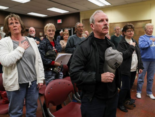 Pleasant Ridge residents gather after a City Hall meeting the day a ruling was issued in their favor in a case against the city of Charlestown. Dec. 4, 2017