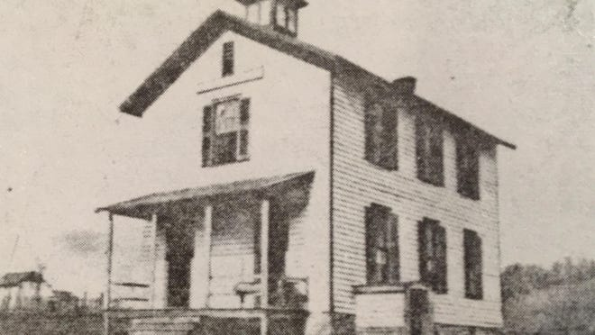 This is the original frame school building as it looked in 1909.
