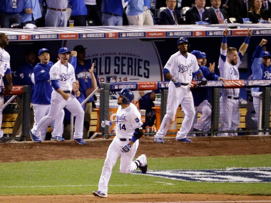 Kansas City Royals' Omar Infante celebrates after hitting a two-run home run during the sixth inning of Game 2.