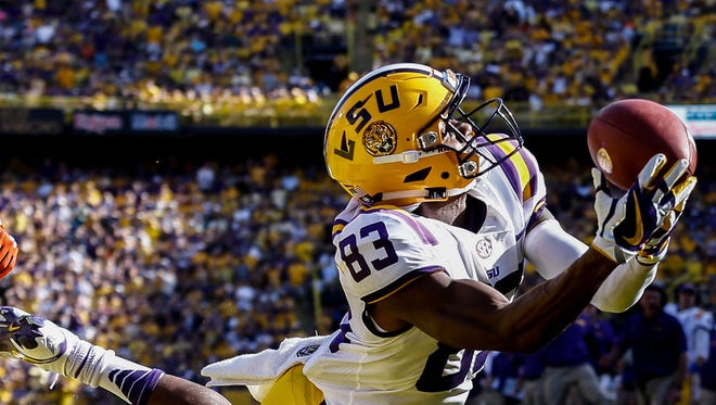 LSU Tigers wide receiver Russell Gage dives for a touchdown catch past Auburn Tigers defensive back Jamel Dean during the second quarter of a game at Tiger Stadium.