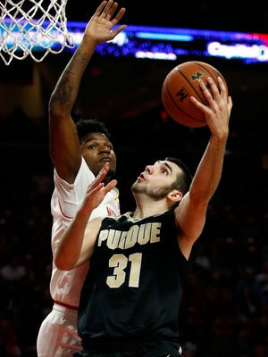 Purdue guard Dakota Mathias (31) shoots against Maryland guard Dion Wiley in the first half of an NCAA college basketball game in College Park, Md., Friday, Dec. 1, 2017. (AP Photo/Patrick Semansky)