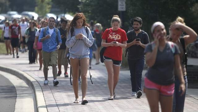 Ball State students walk along McKinley Street during a passing period in this file photo.