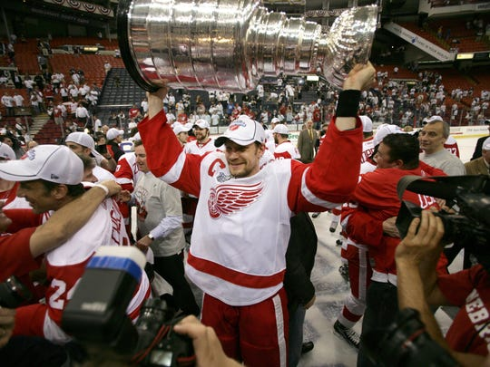 Detroit's Nicklas Lidstrom holds the Stanley Cup after