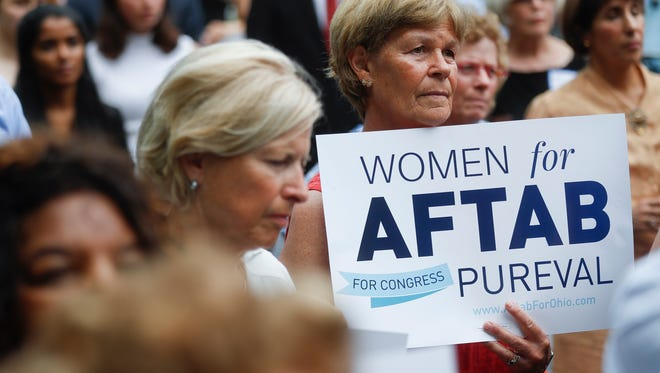 "Supporters gather to listen to Former U.S. Rep. Gabby Giffords and Hamilton County Clerk of Courts Aftab Pureval speak during the ""Women for Aftab"" advocacy group kickoff event in support of Pureval's 1st House District challenge to veteran Republican Rep. Steve Chabot, Wednesday, June 13, 2018, in Cincinnati. Pureval pledges to support pay equity, protecting health care coverage and paid family leave. (AP Photo/John Minchillo)"