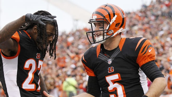 Former Alabama teammates Cincinnati Bengals cornerback Dre Kirkpatrick (27) and quarterback AJ McCarron (5) celebrate McCarron's first NFL Career touchdown in the second quarter of the NFL Week 14 game between the Cincinnati Bengals and the Pittsburgh Steelers at Paul Brown Stadium in downtown Cincinnati on Sunday, Dec. 13, 2015. At the half, the Steelers led 16-7.