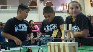 In this file photo, students work on a robot at the FIRST LEGO League competition at the Father Duenas Memorial Phoenix Center.