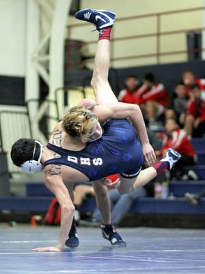 Silver's Lonnie Sandoval takes down Deming's Manuel Carrasco during Wednesday's dual meet in Deming. Sandoval won, 4-1.