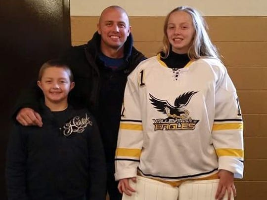 Breese Burlingame, right, with her father, Eric, and brother. She was one of two goalies chosen for the East Coast Selects team, one of five regional squads.