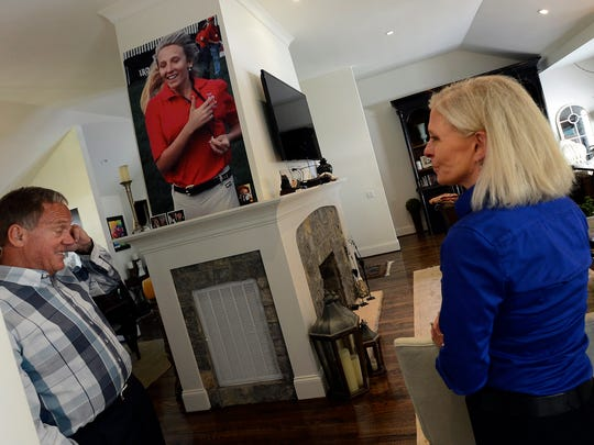 At their home in Nashville, Tenn. on Tuesday, June 7, 2016, Bruce and Betty Mason talk about their daughter Katy, shown in a photograph on the wall. Katy battled drug addiction for several years, but during one period after rehab she worked at the Steeplechase. Katy died when she was 19 years old.