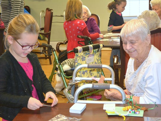 Horseheads fifth graders visit with residents at Bethany