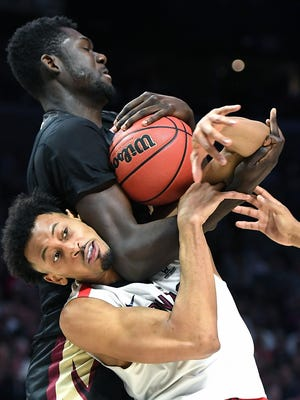 Gonzaga's Jonathan Williams, bottom, battles for a rebound with Florida State's Christ Koumadje during the second half.