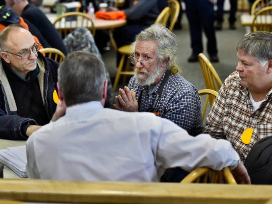 Proposed gun bill opponents (from left) Dick Shaw of Bartonsville, Ed Cutler of Westminster and Tim Ordway of Bennington speak with Senate President Pro Tempore John Campbell, D-Windsor (center), as they gather at the Statehouse in Montpelier on Tuesday, January 27, 2015.