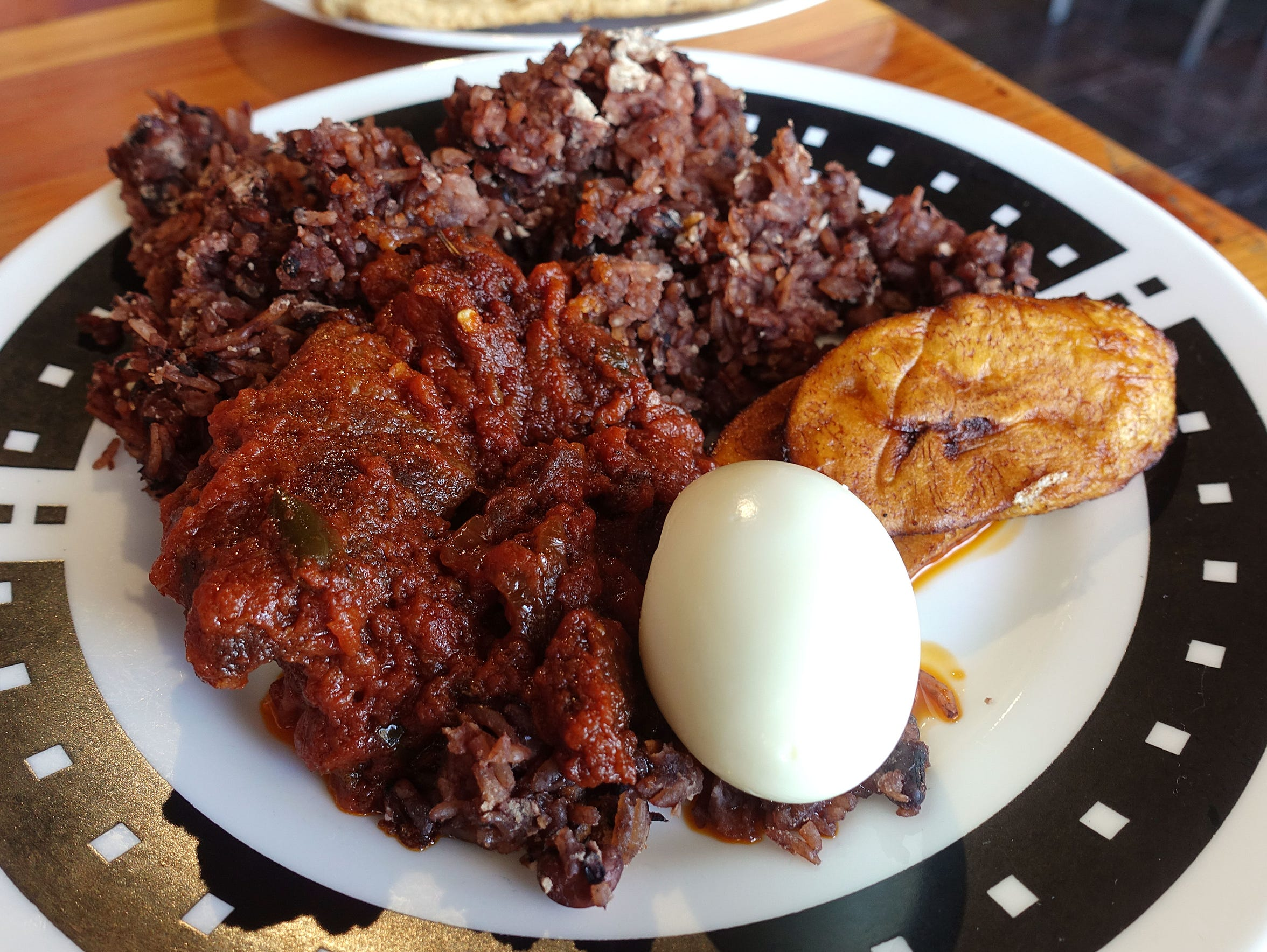 Waakye with goat stew, fried plantains and hard boiled egg at Jollof King in Tempe.