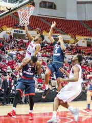 UL guard Kasey Shepherd (5) goes over the top for two points in a win over South Alabama earlier this season.