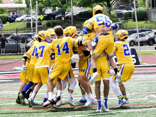 The leap for joy begins as the Mariemont Warriors take the Division II State Lacrosse Championship. June 3, 2017