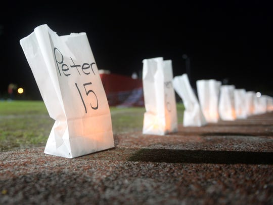 About 300 people gathered Monday, Feb. 19, 2018 at the Citrus Bowl at Vero Beach High School for a candlelight vigil to honor those killed at Marjory Stoneman Douglas High School last week. Vigils were held in 15 counties across the state and was organized by the Florida PTA.