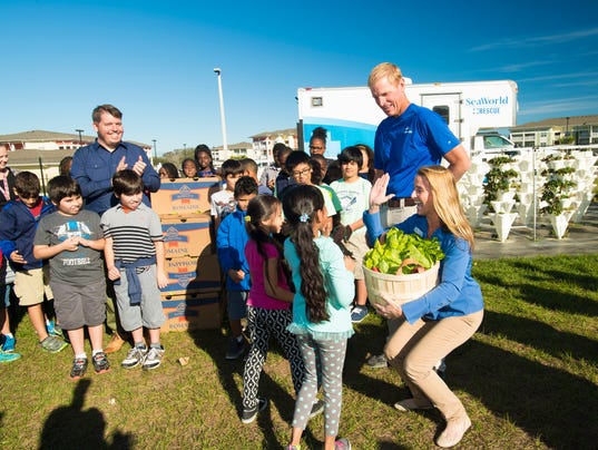 Students donate lettuce to seaworld s manatee rescue program for Millennia gardens elementary school