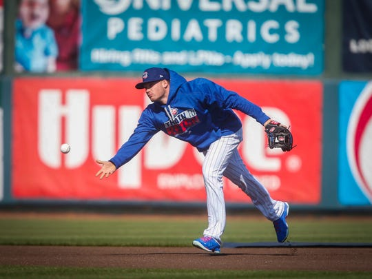 Iowa Cubs second baseman Ian Happ lobs the ball after