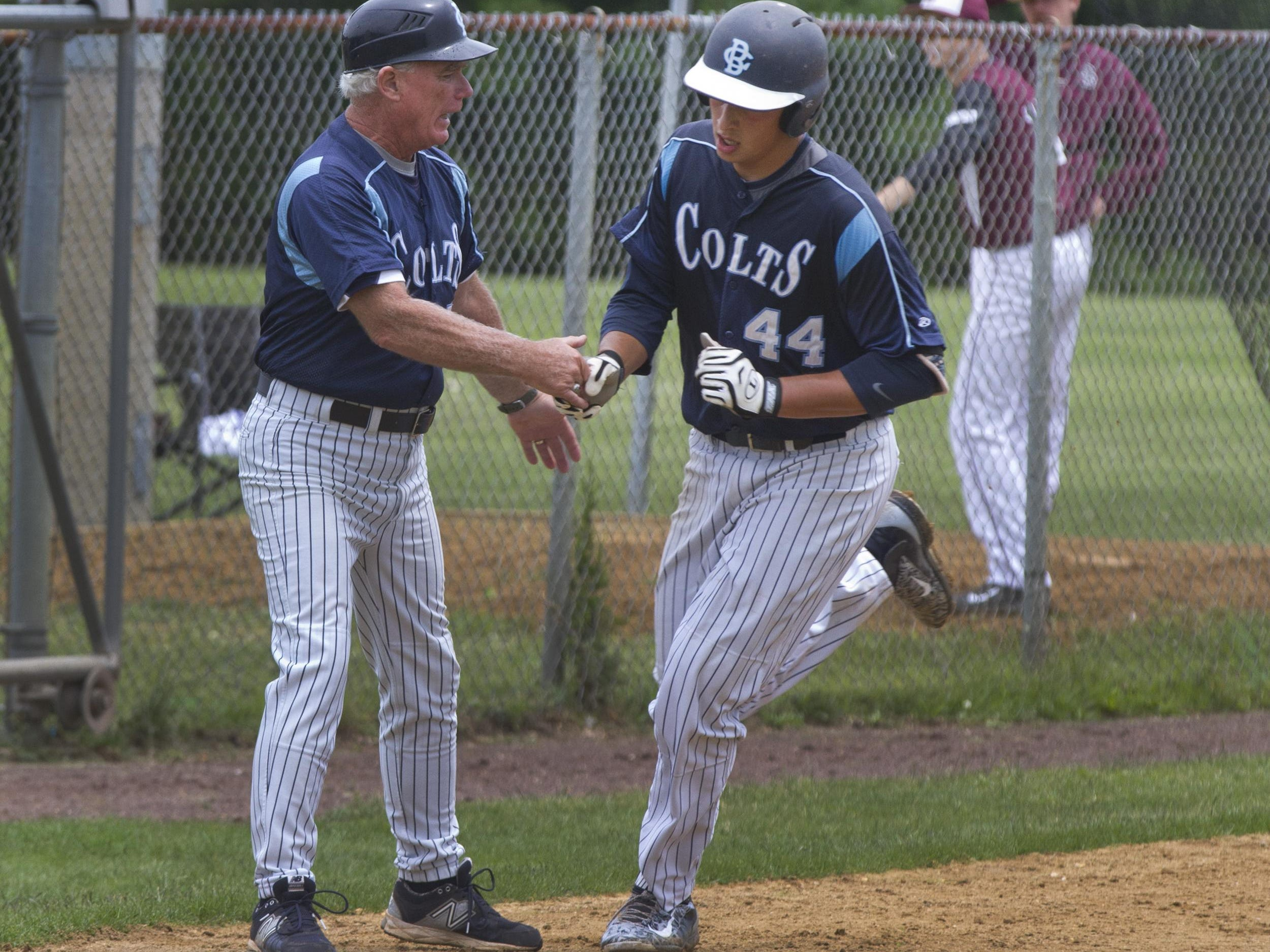 CBA coach Marty Kenney shakes hands with pitcher Luca Dalatri after he hits his team's second home run of game. Christian Brothers Academy vs Don Bosco NJSIAA Non-Public A Baseball Championship in Toms River, NJ on June 6 2015. Peter Ackerman/Staff Photographer