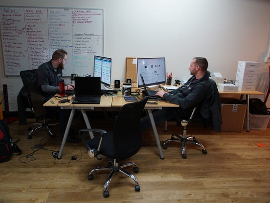 (left to right) Max Henig, a network engineer, and Kevin Kriss, operations, work in the office in downtown Wilmington.