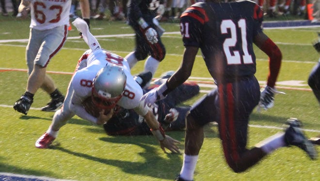 Goshen quarterback  Isaac Hart keeps his feet and dives for the touchdown.
