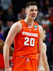 CHICAGO, IL - MARCH 27: Tyler Lydon #20 of the Syracuse Orange celebrates in the second half against the Virginia Cavaliers during the 2016 NCAA Men's Basketball Tournament Midwest Regional Final at United Center on March 27, 2016 in Chicago, Illinois. (Photo by Jamie Squire/Getty Images)