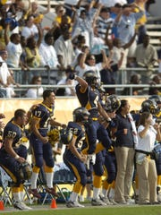 Naples celebrates Kyle Lindquist's game-saving interception at the 2007 FHSAA 3A Football Finals at the Citrus Bowl in Orlando. Naples beat St. Augustine to win the program's second state title.