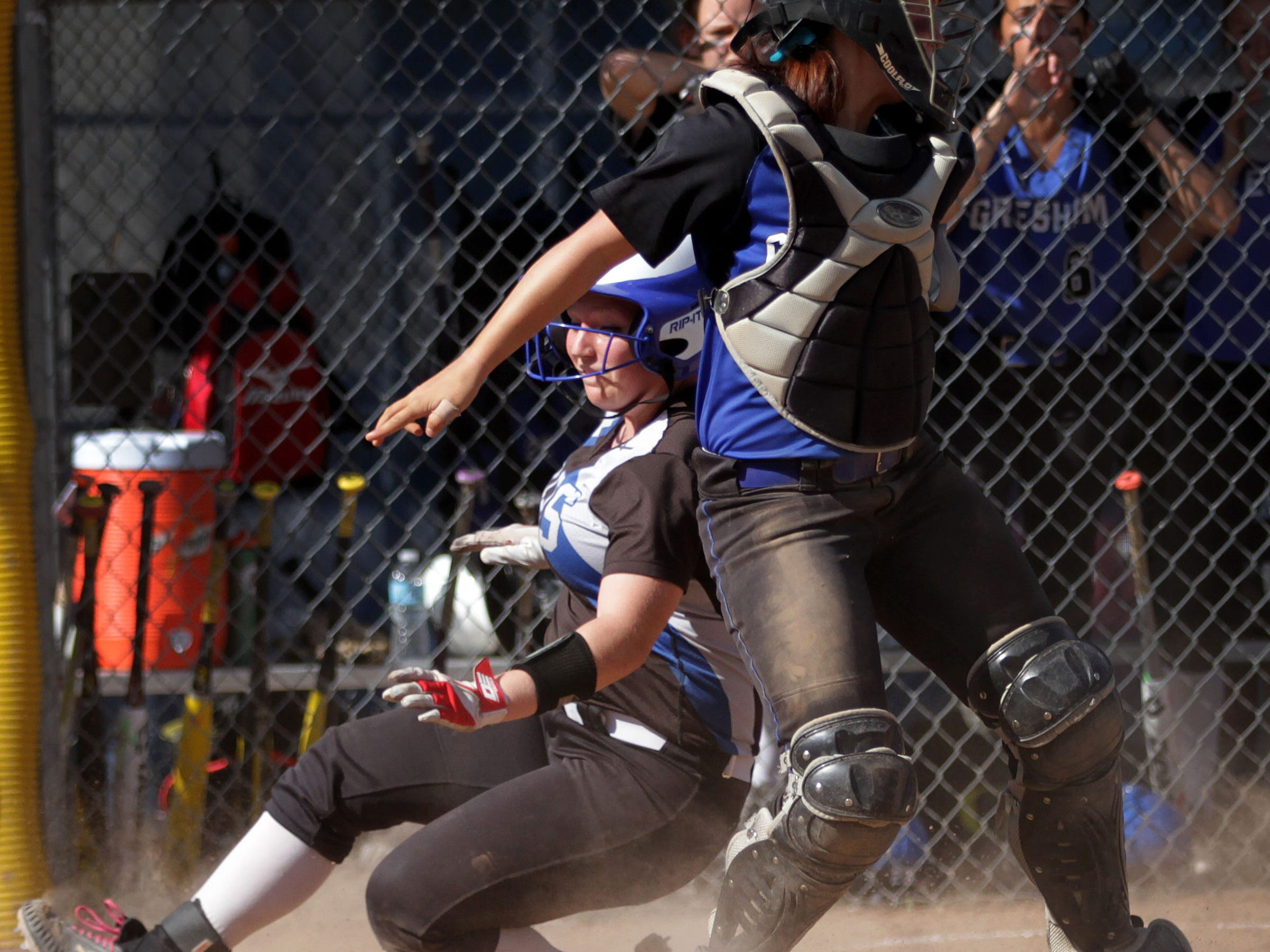 Gresham's Bree Gibbons (13) tags McNary's Madisen Oliver (3) out at home in the Gresham vs. McNary softball game, in the first round of the OSAA class 6A state playoffs, at McNary High School in Keizer on Monday, May 25, 2015. McNary won the game 11-7.