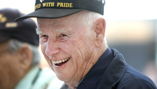 Howard Requardt, 89, of Edgewood, smiles during the send off ceremony at the Cincinnati/Northern Kentucky International Airport, for himself and three other local veterans heading to DC to join the national recognition of the 70th anniversary of Victory in Europe Day. Requardt served in Marine Corps from 1943-1946 and fought in the Battle of Okinawa.