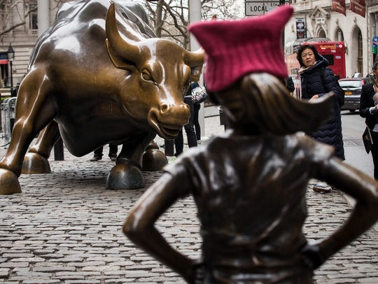 'The Fearless Girl' statue stands across from the iconic