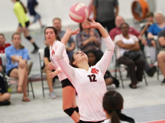 NFC's Alicia Price sets the ball during their match